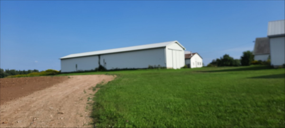Rear view of large 26 x 126 ft. barn